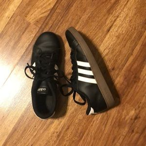 Black with white stripes adidas shoes